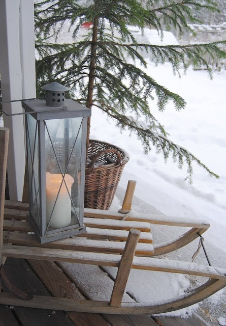Vintage sledge & lantern on a snowy day - nice little tableau for Crimbo decorating