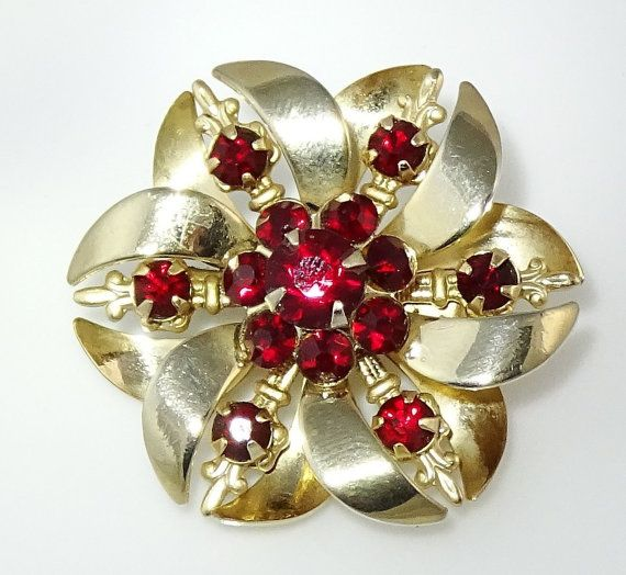 Gorgeous floral brooch with red chaton stones. Nice fleur-de-lys detailing on the arms between the main petals. #adoredblessings