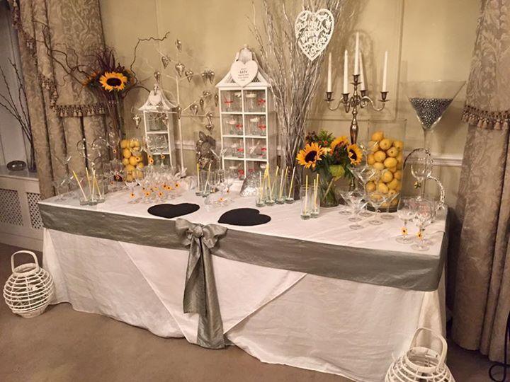 Wedding arrival drinks table. Orange, yellow, grey & white theme - Blackbrook House