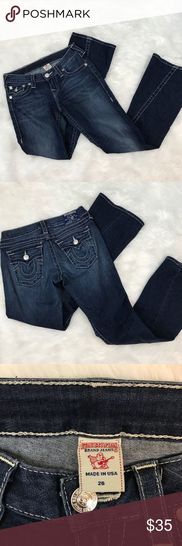 True Religion women's petite flare jeans size 26 Women's true religion jeans petite flare. Size 26. Twisted seam at leg. Zip and one button closure. Horseshoe stitching at the button flap and coin pockets. Machine wash cold. 89% cotton. 8% polyester. 3% elastane. Excellent used condition! No rips, tears or stains! No fraying at the bottom of the legs. Approximate measurements with the jeans laying flat: waist: 14 inches. Inseam: 30.5 inches. Front rise: 8 inches. True Religion Jeans Flare…