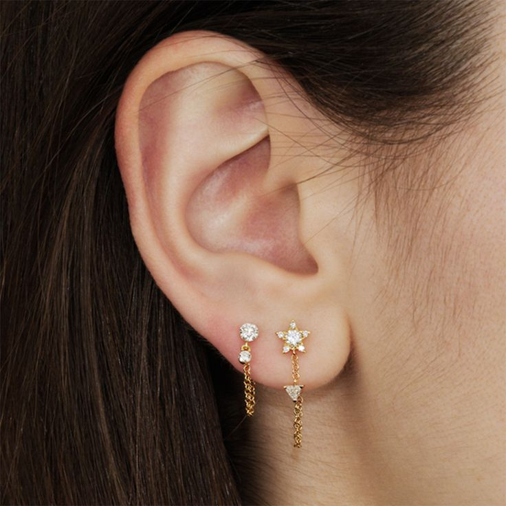 If you can't decide between the minimalist wrap chain and a diamond stud, this dainty earring by Maria Tash is the best of both worlds.