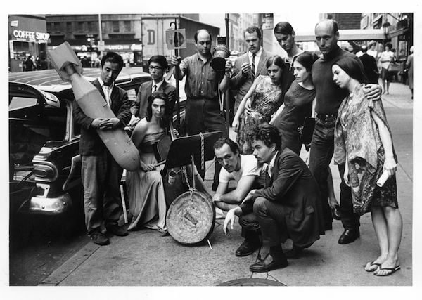 Peter Moore. Publicity photograph for 3rd Annual New York Avant-Garde Festival, August 26, 1965; left to right: Nam June Paik, Charlotte Moorman, Takehisa Kosugi, Gary Harris, Dick Higgins, Judith Kuemmerle, Kenneth King, Meredith Monk, Al Kurchin, Phoebe Neville; in front, kneeling: Philip Corner and James Tenney. Photo © Barbara Moore/Licensed by VAGA, NY.