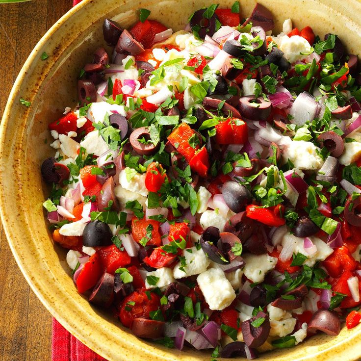Seven-Layer Mediterranean Dip Recipe -I like traditional seven-layer Mexican dip, but I love Mediterranean ingredients even more. When I made this mashup, my husband wolfed it down. And he won't even touch hummus or Greek olives on their own! —Bee Engelhart, Bloomfield Township, Michigan