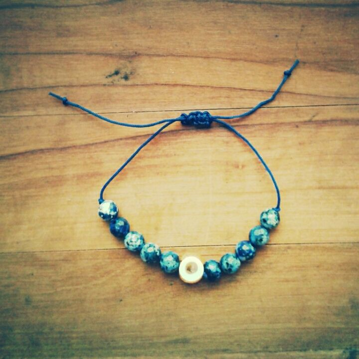 kids bracelet / hand knotted / navyblue jade beads with yellow evil eye bead .