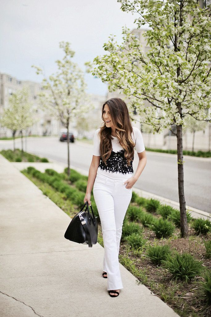 With a lace tank, flared jeans, and sandals.