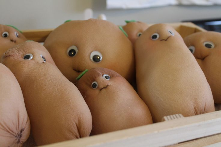 Small Potatoes Party prop for Giggle and Hoot, hand made from stockings and googly eyes. A tuft of green felt on top. Kids loved these.