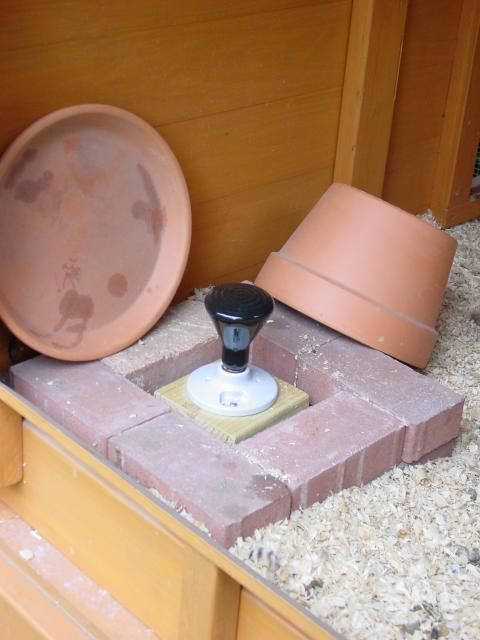 Chicken water/coop heater: Pavers + heat lamp mounted to  scrap piece of 2x4, cover with upside down terracotta pot + saucer, then water (secured with hang chain).