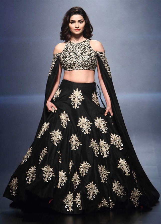 Prachi Desai at the LFW 2016 event in a beautiful black and gold, off-shoulder outfit with a cape attached to the sleeves. Source: Vogue