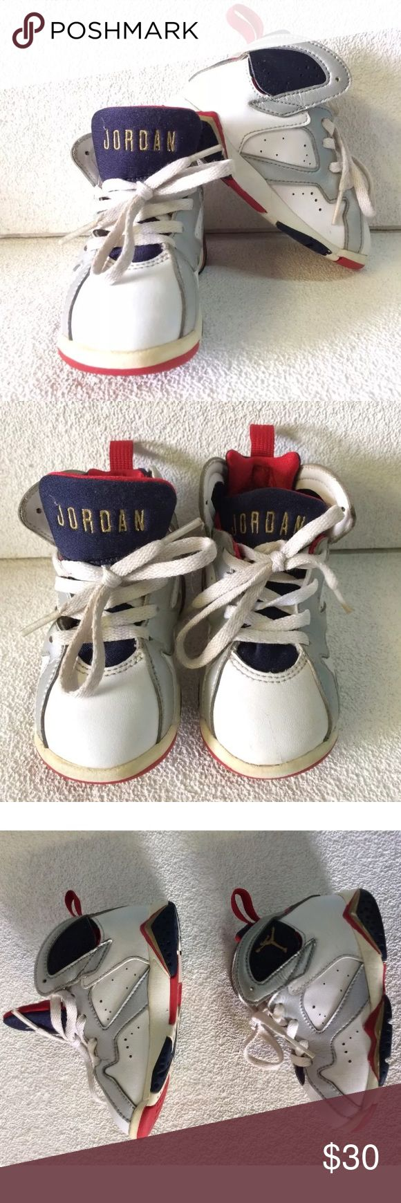 Air Jordan 7 Retro Olympic size 7C kids Jordan Used in good condition. Some dirt and wear. Size 7c. See pictures for details and condition. Jordan Shoes Sneakers