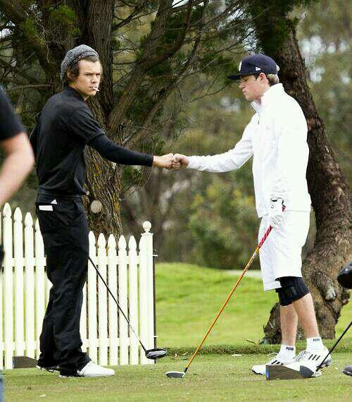 Narry fist bumping
