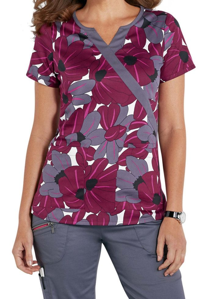 A striking flower print is the highlight of the Petals mock wrap print scrub top from the Beyond Scrubs collection. The soft, stretch material gives you serious comfort throughout your workday, while two roomy front pockets and a cell phone pocket provide plenty of room to store your essentials.