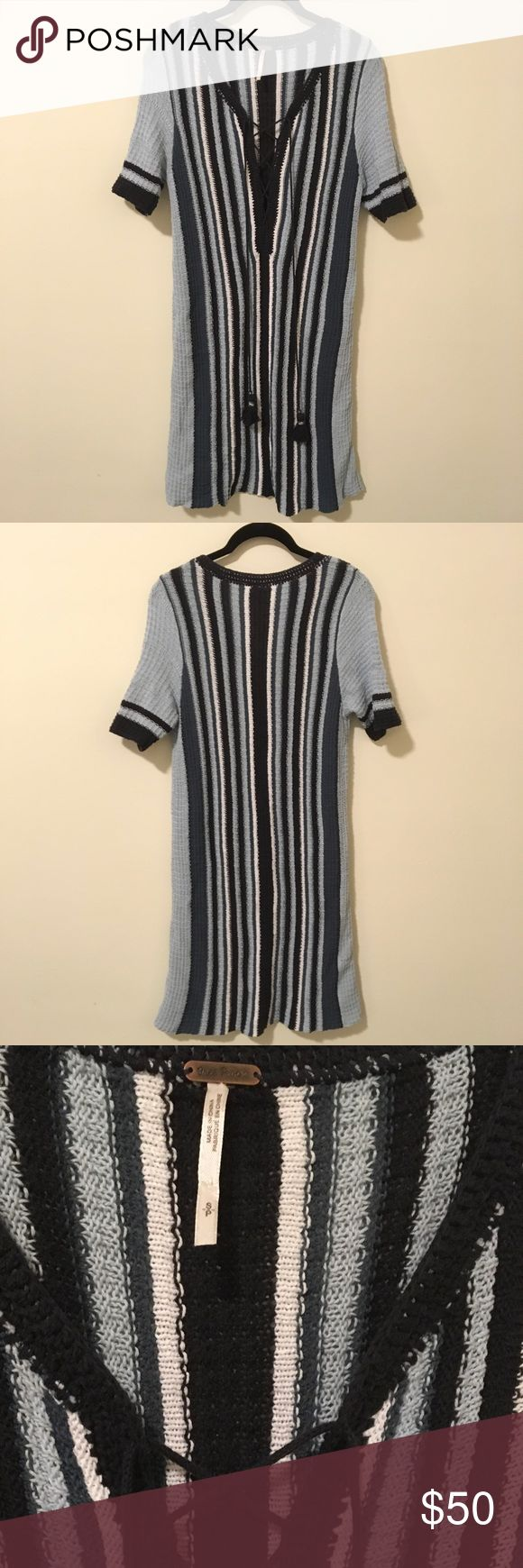 FREE PEOPLE Blue Lollipops Lace Up Sweater Dress Free People Lollipops dress with blue tones and stripes with a Lace Up front - made of cotton and is a light Knit sweater fabric. Size small and is just above the knee on me and I'm 5'5. Free People Dresses Midi