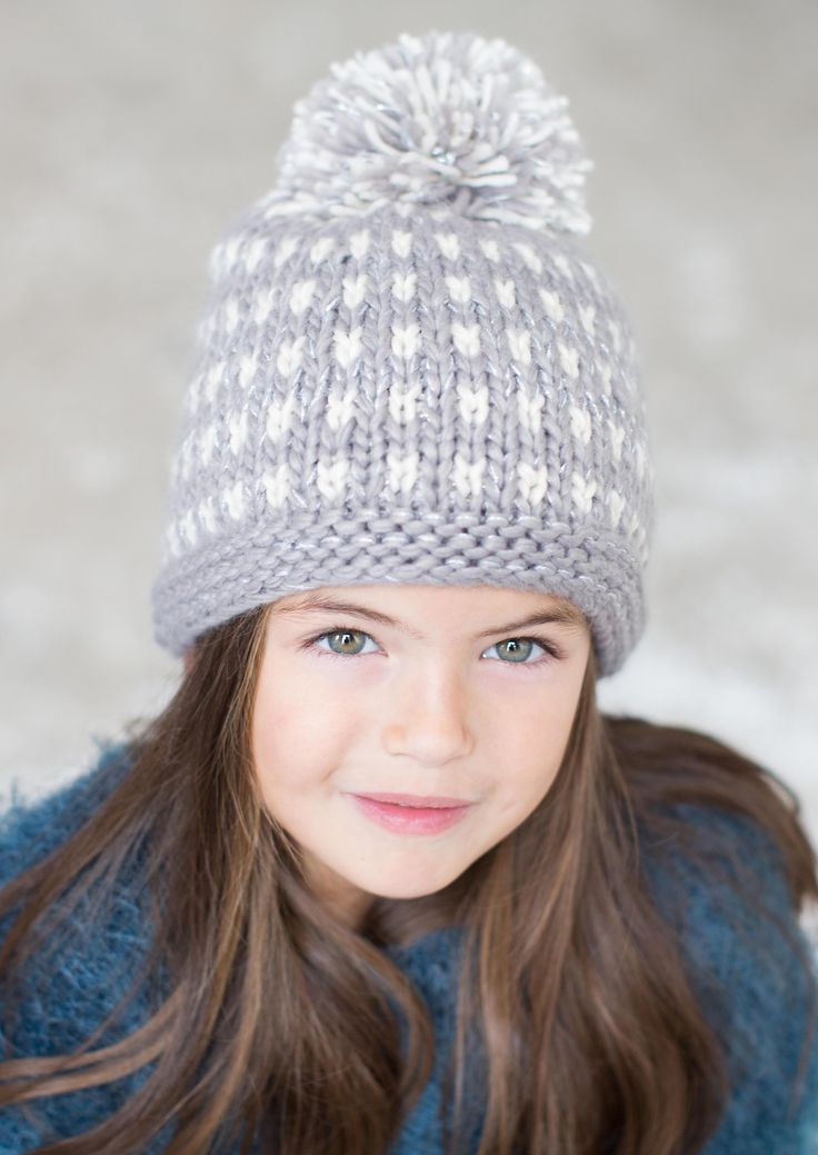 Keep cosy this winter while supporting the innocent smoothie 'Big Knit' campaign for Age UK in our limited edition Women's Strawberry Pom Pom Hand-Knitted Hat.