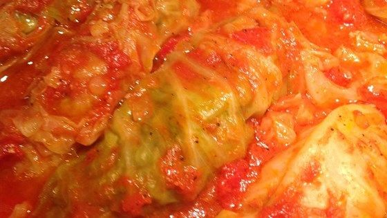 Halupki, also known as stuffed cabbage, is a dish made of rice, beef, and pork encased in cabbage. It's drizzled with a sweet tomato sauce. Serve with mashed potatoes, if desired.