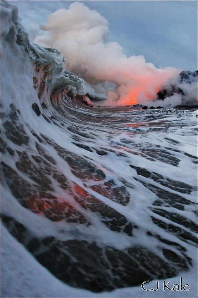 This photo, taken by nature photographer CJ Kale, is of lava hitting the surf off of the main island of Hawaii. The water was filled with volcanic glass and lava bombs; the water vapor is the result of the lava superheating the seawater and evaporating it. Lava cools rapidly when it hits seawater, causing minerals to form and crystallize quickly.