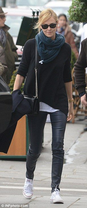 Pounding the pavements: Charlize donned a pair of trainers as she took in the sights...