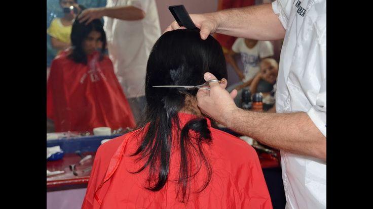 Girl long to short hair cut