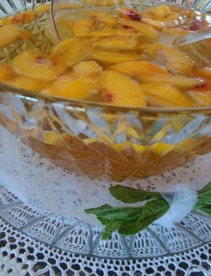 Baptist Champagne Punch  Punch bowl Version:  1 2-liter of Ginger Ale (chilled)    1 64-oz bottle of Welch's White Grape Peach Juice (we used White Grape Peach Mango this time and it was wonderful)    Pour contents of both bottles into bowl and float frozen peach slices on the surface