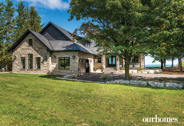 Even the garage is handsomely clad in stone and cut in with windows to provide a balanced aesthetic when viewed from the pool and yard.  @alairhomes http://www.ourhomes.ca/articles/build/article/wake-up-to-this-sky-blue-view-from-the-edge