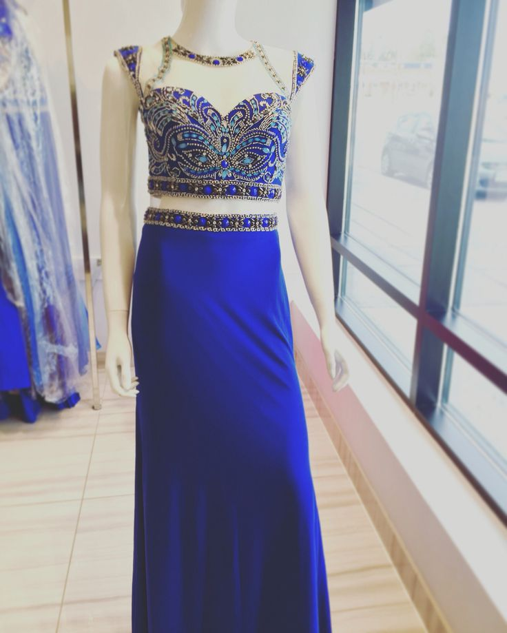Beautiful prom gown with peel-a-boo netting and available in different colours !