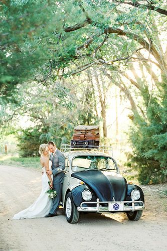 Beautiful photo of couple with old VW Bug as the wedding car.