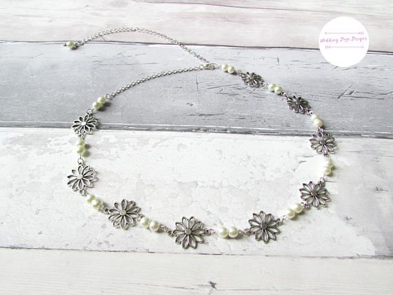 Check out this item in my Etsy shop https://www.etsy.com/uk/listing/543071895/flower-hair-chain-bohemian-hair-chain