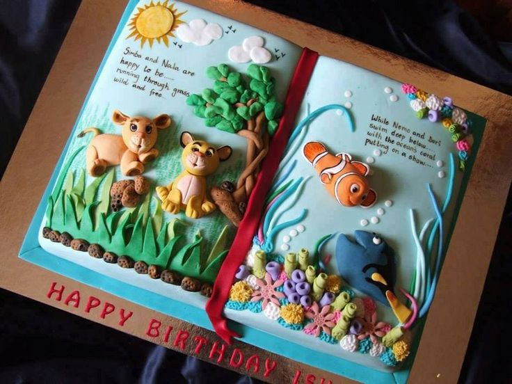 Cute lion king/finding nemo book cake for a child's birthday