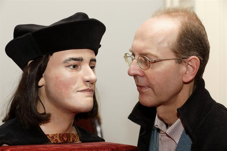 Michael Ibsen, a descendant of England's King Richard III, poses for pictures with a plastic model made from the recently discovered skull of the king, during a press conference in London on Feb. 5, 2013.