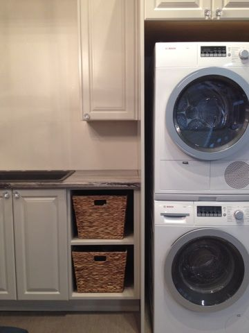 Step inside this beautiful laundry room display and take a moment to realize that laundry day doesn't have to be a hassle!