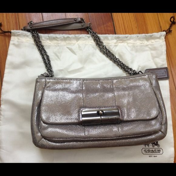 "COACH METALLIC KRISTEN OCCASION BAG Slightly used, still in great condition and comes with dust bag. 11""x 2""x 6""h. It has two compartments with individual zippers and a front flap metal clasp. Coach Bags"