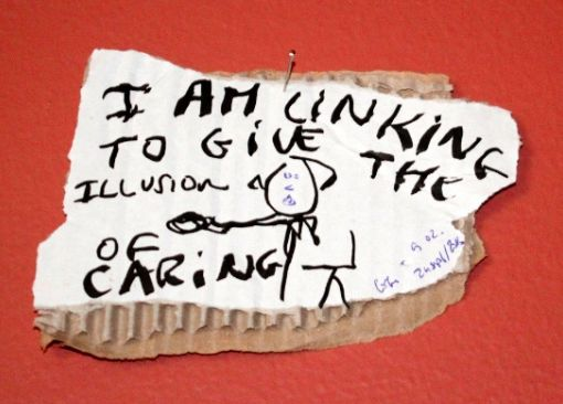 "I am linking to give the illusion of caring, black marker and blue pen text and drawing on carton, 15 x 10 cm Biennalist  #BERLINBIENNALE  : Fear of content "" ( Berlin Biennial )"
