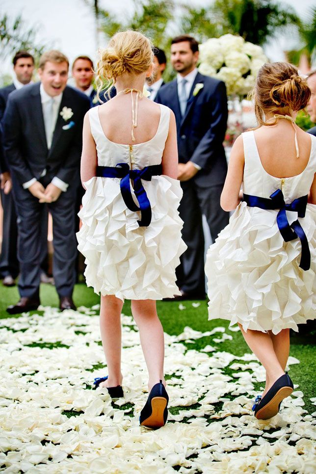 Love these ruffled flower girl dresses with navy bows.