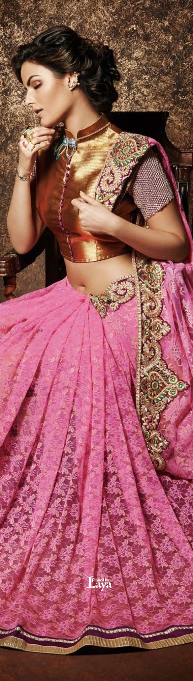 Pink and gold saree or sari with blouse. Indian fashion.