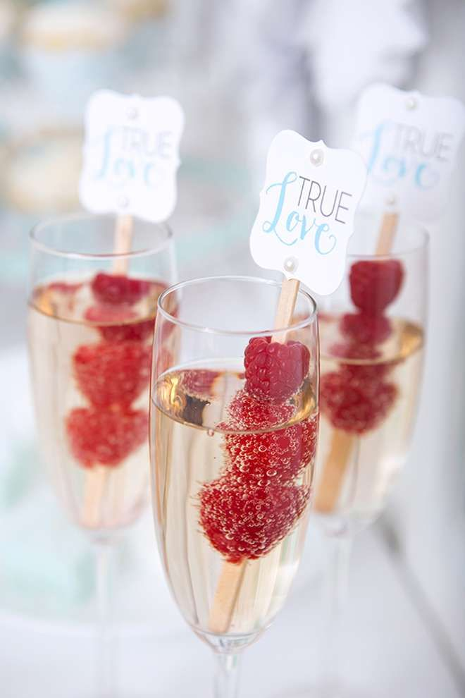 Adorable champagne glasses with raspberries for any Valentine night or party. | Catchmyparty