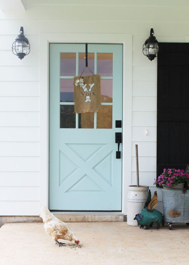 "The York Family's Sugarberry Cottage Farmhouse Louisiana ""Watery"" by Sherwin williams. Door and porch roof"