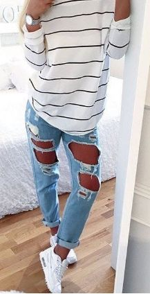 distressed, light wash denim with white and black sweater.