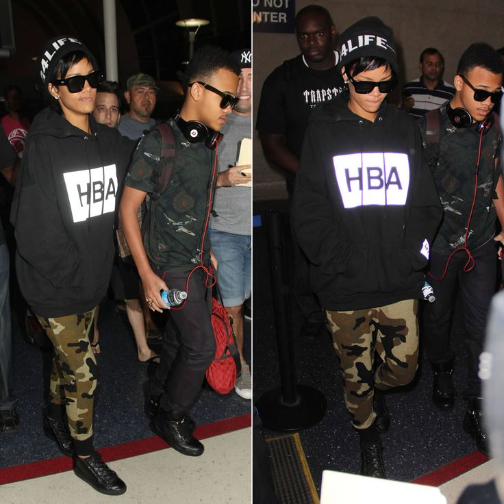 Rihanna wearing Hood by Air HBA logo hoodie, Rihanna for River Island camouflage jumpsuit and black beanie, Le Specs sunglasses