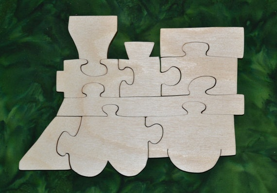 """This Train Puzzle is fun to do and assists in the development of small motor, hand-eye coordination, visualization and problem solving skills all of which are important in the process of reading. Our puzzles are made from toy quality 1/2"""" Baltic birch plywood and is rubbed with AMF Naturals, an oil wax finish that is completely safe. Dimensions: 7"""" high, 9.75"""" wide"""