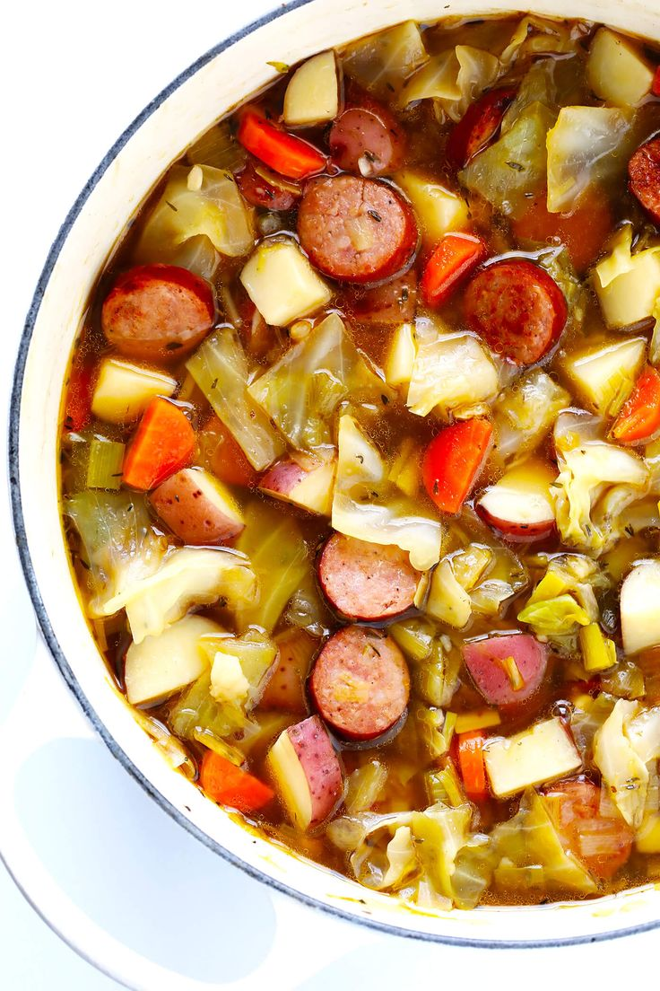 This Cabbage, Sausage and Potato Soup recipe is hearty and comforting, easy to make, and so savory and delicious. My kind of cabbage soup! | gimmesomeoven.com #cabbagesoup #glutenfree #comfortfood #souprecipe