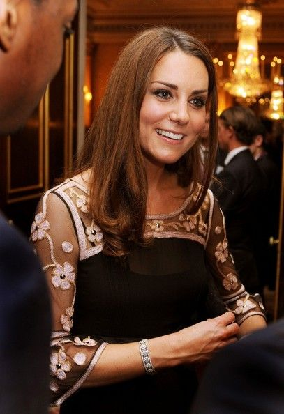 23rd October, 2012: The Duchess of Cambridge smiles as she talks to Olympic and Paralympic Athletes during a reception for Team GB Medallists at the 2012 Olympic and Paralympic Games at Buckingham Palace, London.