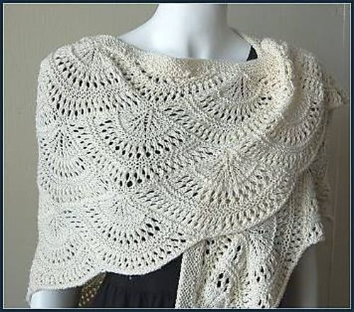Constructed of knitted, fan-shaped motifs to form a scalloped, triangular shawl. A lovely drape to this fan stitch shawl when knit in Panda Silk DK - a blend of bamboo, superwash Merino wool and combed silk. Cozy and eye-catching in our new Nocturne DK yarn--wonderful!