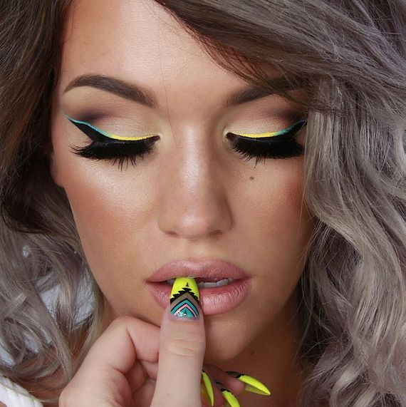 She used Anastasia's Waterproof Creme Colors in Yellow and Ice Blue, plus NudeStix in Whisper on her lips.