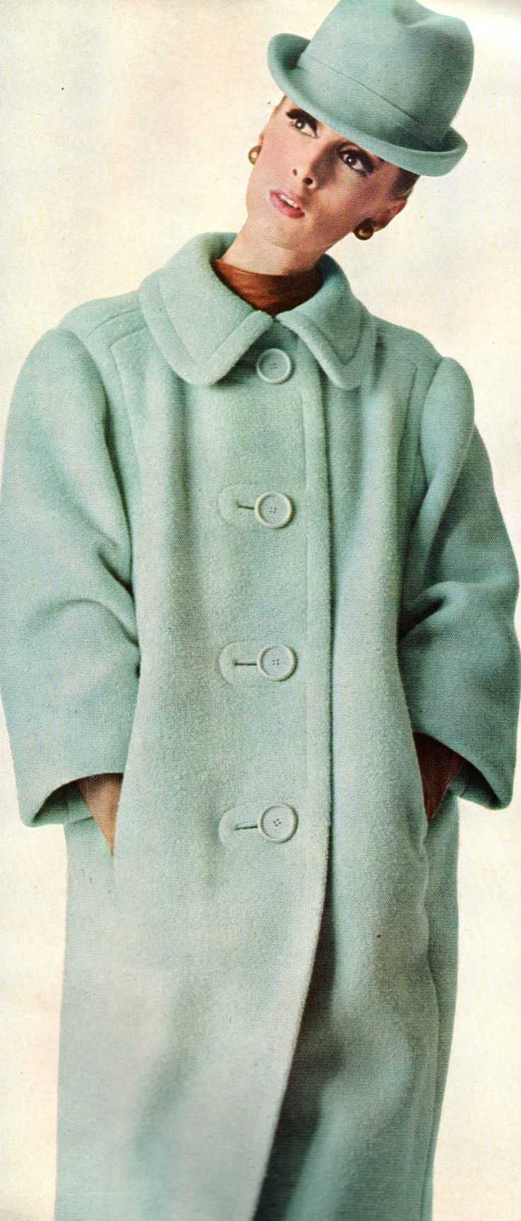 Wilhelmina wearing Leslie Morris coat at Bergdorf Goodman, hat Halston 1966