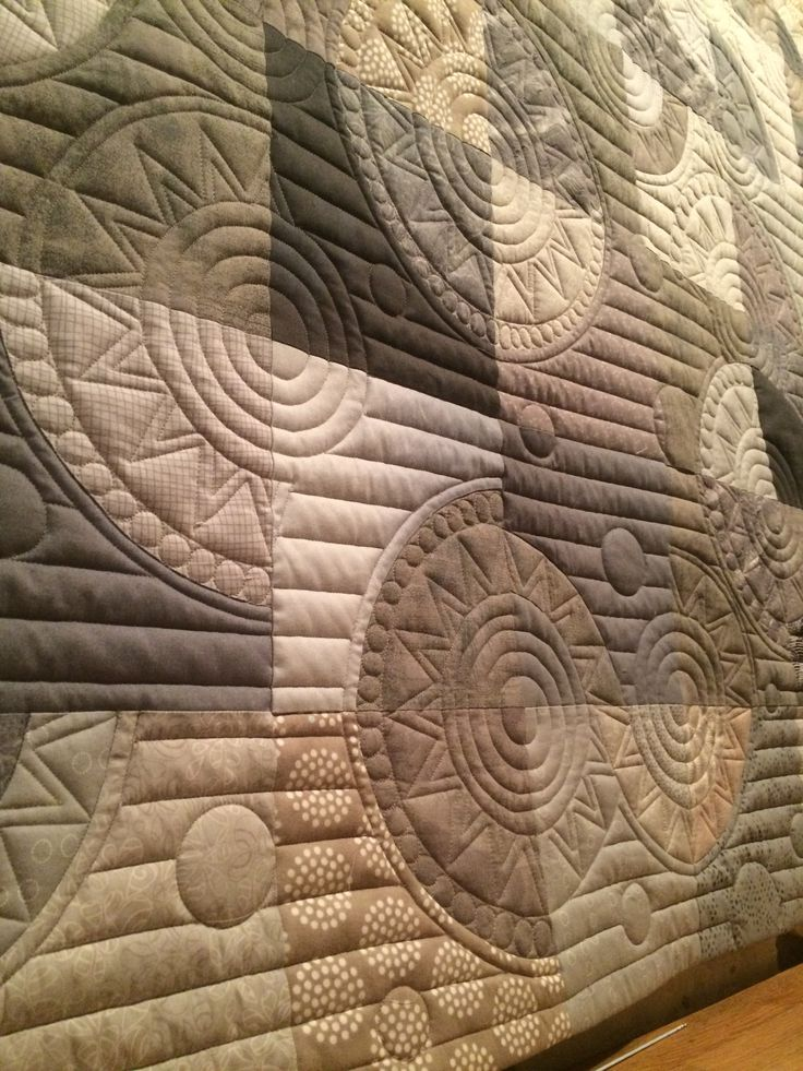 Gorgeous quilting on this quilt by Lauretta, which was made on her APQS Millie machine.  We LOVE the use of the straight lines. What are you working on at the moment?