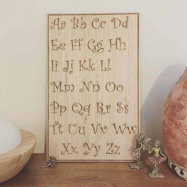 Perfect addition to the nursery and kids room!   Shop the Akuko Alphabet Board via the link in bio.  Custom laser etched on Tassie Oak timber.   Great for decorating the nursery or kids room. Perfect gift for baby showers,birthdays, christening, baptism, name day.  Shelfie or flatlay.
