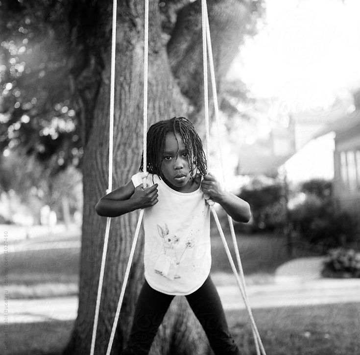 African American girl on a swing. Film scan shot on a Yashica Mat 124-G Camera, using Ilford HP5, 120 square format. #film #childhood #ilfordHP5 #filmisnotdead