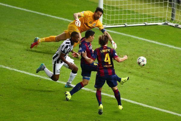 Luis Suarez of Barcelona scores his team's second goal during the UEFA Champions League Final between Juventus and FC Barcelona at Olympiastadion on June 6, 2015 in Berlin, Germany.