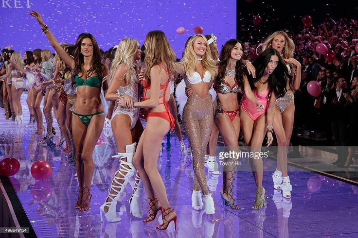 Models Alessandra Ambrosio, Elsa Hosk, Behati Prinsloo, Candice Swanepoel, Lily Aldridge, Adriana Lima, and Romee Strijd dance in the finale at the 2015 Victoria's Secret Fashion Show at Lexington Avenue Armory on November 10, 2015 in New York City.