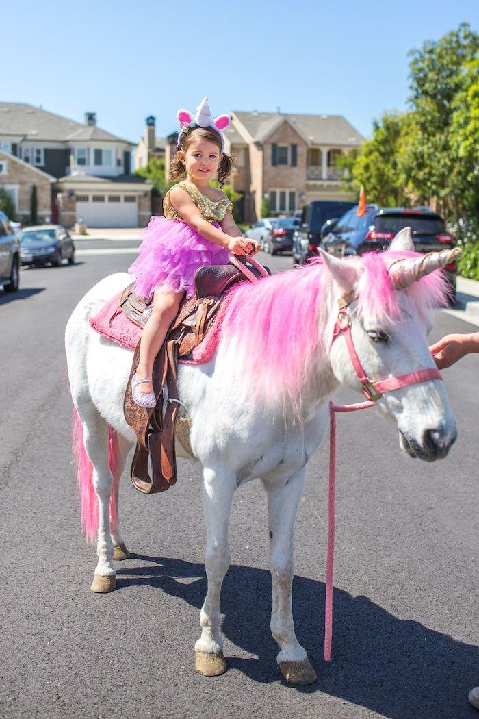 Unicorn rides from a Magical Unicorn Birthday Party on Kara's Party Ideas | KarasPartyIdeas.com (30)