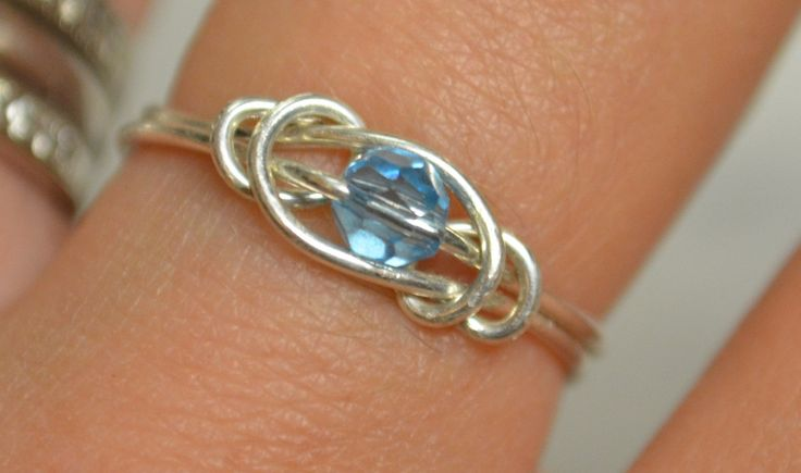Aquamarine love knot ring sterling silver wire handmade with Swarovski crystal March birthstone Jewelry made to order. $15.00, via Etsy.